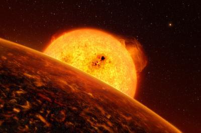 Exoplaneta CoRoT-7 b a její mateřská hvězda v představách malíře.