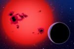 GJ 1214 b (vpravo) u červeného trpaslíka v představách malíře.