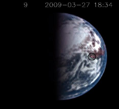 Odraz slunečních paprsků o vodní hladinu na snímku ze sondy Deep Impact. Autor: Don Lindler, Sigma Space Corporation/GSFC