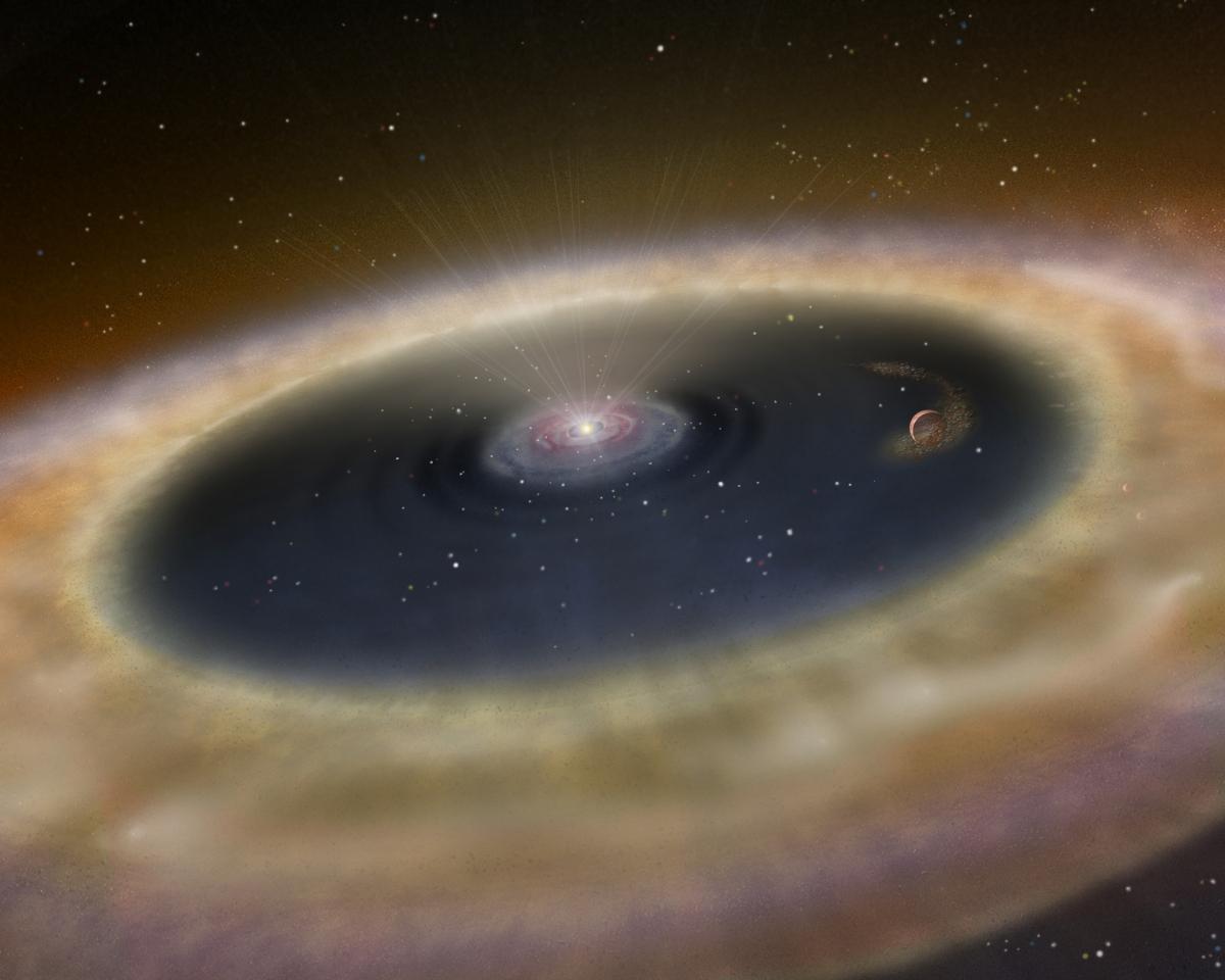 Protoplanetární disk v představách malíře. Credit: Karen L. Teramura, UH IfA