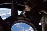 1280px-Tracy_Caldwell_Dyson_in_Cupola_ISS