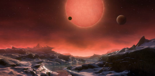 TRAPPIST-1 v představách malíře. Credit: ESO/M. Kornmesser