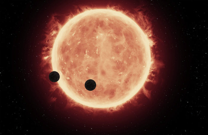 Tranzit exoplanet TRAPPIST-1b a TRAPPIST-1c (kresba). Credit: NASA, ESA, and G. Bacon (STScI)
