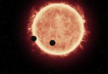 Exoplanety u červeného trpaslíka. credit: NASA, ESA, and G.Bacon (STScI).